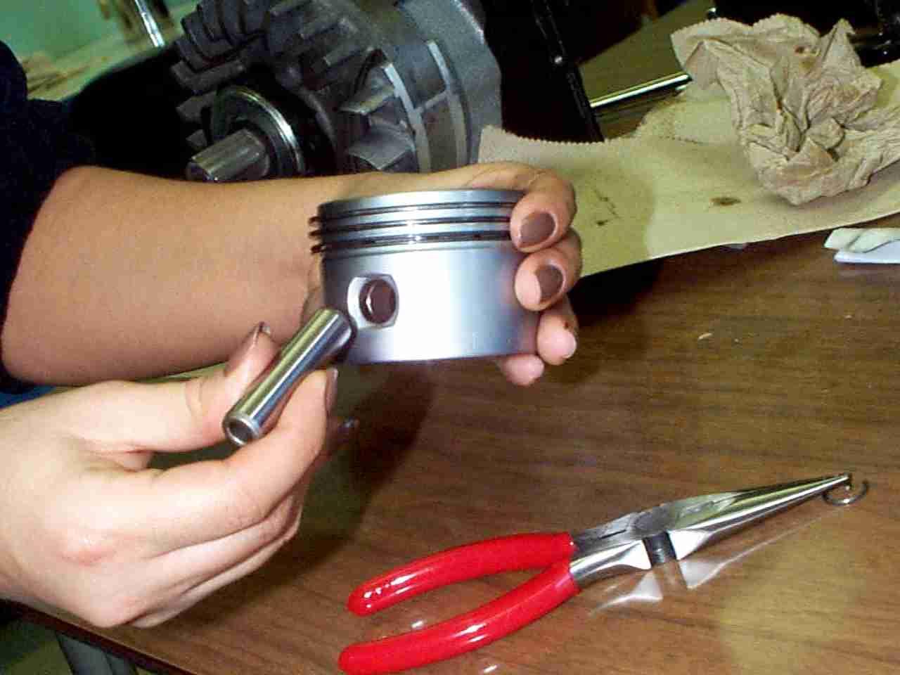 Ensure the letters that were previously marked on the Connecting Rod are  matched and aligned with the letters on the bottom side of the Piston as  shown.