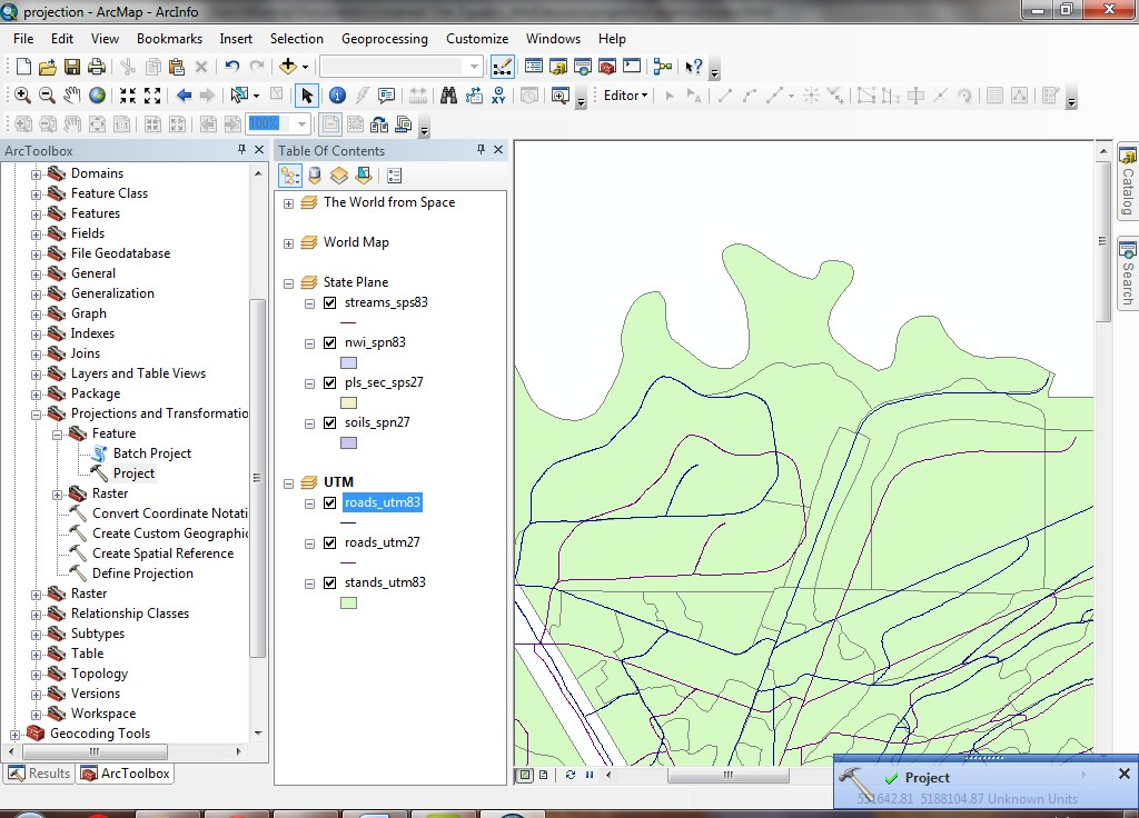 map if it is not added please add it turn off the roads_utm27 layer and turn on the new roads_utm83 layer you will see that it now overlaps with